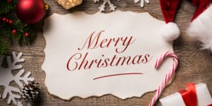 The words Merry Christmas on a holiday themed background
